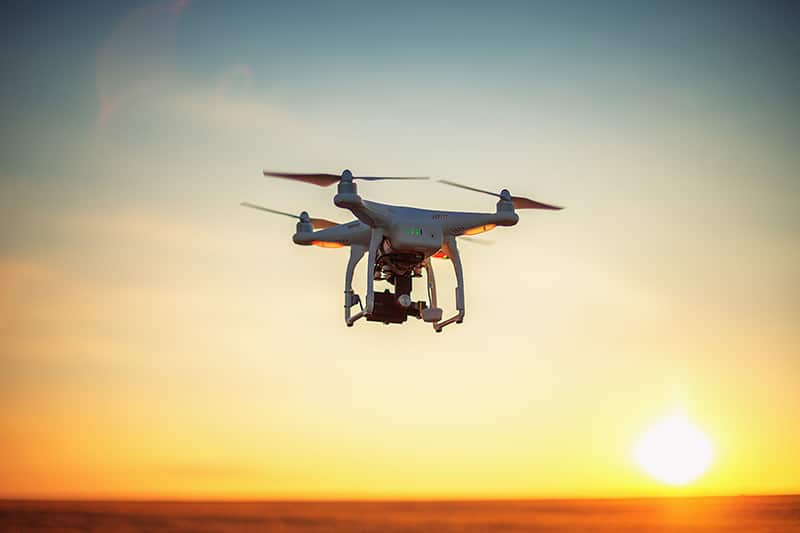 Drone Flying at Sunset - Global Drone Solutions