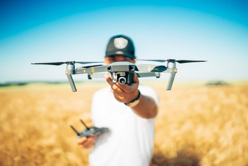 Man holding drone and drone remote